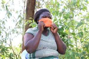 The Water Project: Ematetie Community, Weku Spring -  Putting On Her Mask