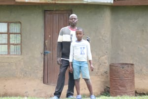 The Water Project: Ematetie Community, Chibusia Spring -  Benson With Son Joshua