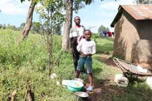 The Water Project: Ematetie Community, Chibusia Spring -  Joshua Washing Utensils