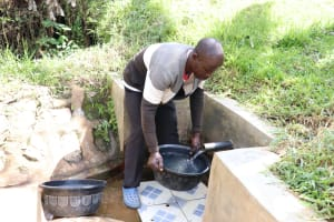 The Water Project: Ematetie Community, Chibusia Spring -  Fetching Water For His Cow