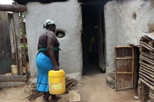 The Water Project: Shamoni Community, Laban Ang'ata Spring -  A Woman Carries Water To Her Home