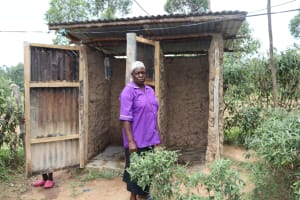 The Water Project: Shamoni Community, Laban Ang'ata Spring -  An Elderly Woman Outside Her Bathroom