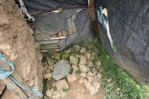 The Water Project: Shamoni Community, Laban Ang'ata Spring -  Bathing Room Floor