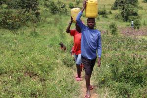 The Water Project: Shamoni Community, Laban Ang'ata Spring -  Carrying Water