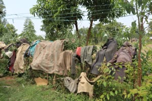 The Water Project: Shamoni Community, Laban Ang'ata Spring -  Clothes Drying On Fence