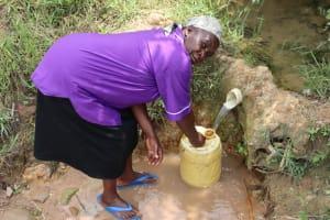 The Water Project: Shamoni Community, Laban Ang'ata Spring -  Collecting Water