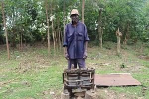 The Water Project: Shamoni Community, Laban Ang'ata Spring -  Mr Angata Behind His Sugarcane Extractor