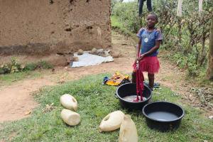 The Water Project: Shamoni Community, Laban Ang'ata Spring -  Washing Her Clothes