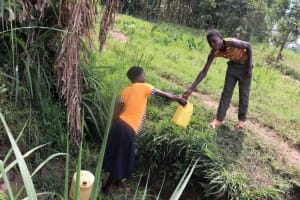 The Water Project: Malekha Central Community, Misiko Spring -  Passing Off A Full Container