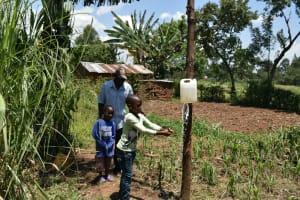The Water Project: Shamoni Community, Shatuma Spring -  Francis Handwashing