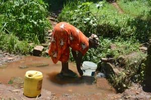 The Water Project: Shamoni Community, Shatuma Spring -  People Collecting Water