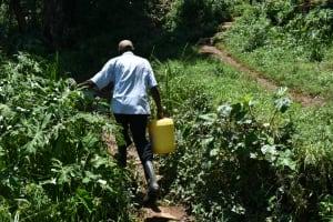 The Water Project: Shamoni Community, Shatuma Spring -  Carrying Water