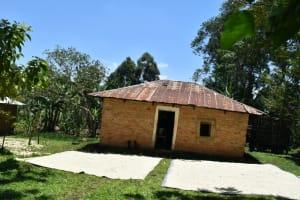 The Water Project: Shamoni Community, Shatuma Spring -  Maize Drying Outside A Home
