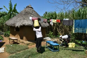 The Water Project: Shianda Community, Akhonya Spring -  Arriving Home With Water