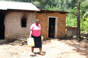 The Water Project: Elwichi Community, Mulunda Spring -  Dora Leaves For The Spring