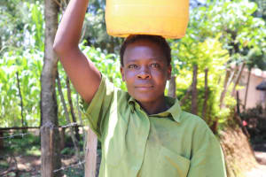 The Water Project: Elwichi Community, Mulunda Spring -  Ruth Carrying Water