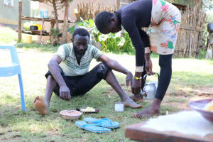 The Water Project: Elwichi Community, Mulunda Spring -  Sir Henry Enjoying Lunch