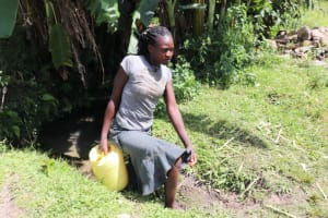 The Water Project: Kalenda A Community, Moro Spring -  Juliet Leaving The Spring