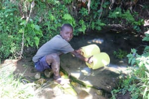 The Water Project: Kalenda A Community, Moro Spring -  Samuel Fetching Water From The Spring