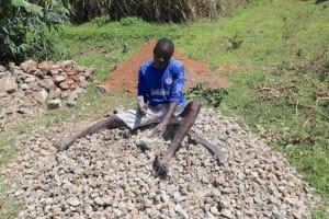The Water Project: Kalenda A Community, Moro Spring -  Titus Splitting Rocks To Gravel