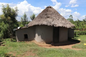 The Water Project: Kalenda A Community, Moro Spring -  Kitchen With Chicken Coop On Left And Goat Pen On Right