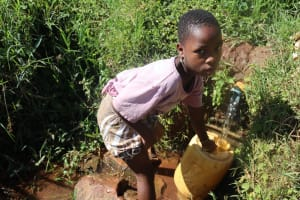 The Water Project: Lukala West Community, Luka Spring -  A Girl Fetching Water