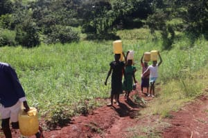 The Water Project: Lukala West Community, Luka Spring -  Leaving The Spring With Water