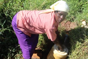 The Water Project: Lukala West Community, Luka Spring -  Roselyne Fetching Water