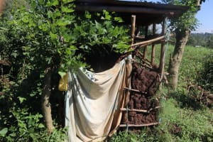 The Water Project: Lukala West Community, Luka Spring -  Latrine With Cloth Door