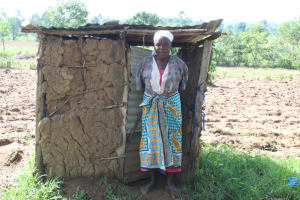 The Water Project: Litinye Community, Vuyanzi Spring -  Outside Her Latrine