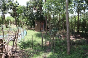 The Water Project: Luyeshe Community, Khausi Spring -  Latrine With Handwashing Station In The Distance