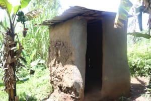 The Water Project: Kalenda A Community, Sanya Spring -  A Latrine