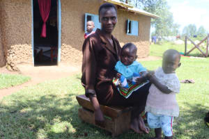 The Water Project: Kalenda A Community, Sanya Spring -  A Woman Taking Care Of Her Babies