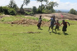 The Water Project: Kalenda A Community, Sanya Spring -  Children Playing Outside