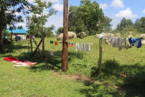 The Water Project: Kalenda A Community, Sanya Spring -  Clothes Being Aired On The Fence