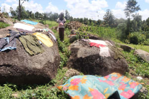 The Water Project: Kalenda A Community, Sanya Spring -  Clothes Out To Dry On The Rocks