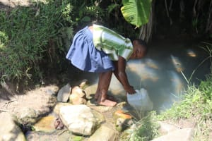 The Water Project: Kalenda A Community, Sanya Spring -  Fetching Water At The Spring