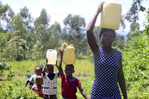 The Water Project: Kalenda A Community, Sanya Spring -  Leaving The Waterpoint