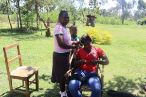The Water Project: Kalenda A Community, Sanya Spring -  Ms Peris Plaiting Her Friends Hair