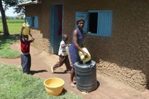 The Water Project: Kalenda A Community, Sanya Spring -  Storing Water For Later Use