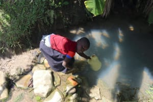 The Water Project: Kalenda A Community, Sanya Spring -  Fetching Water