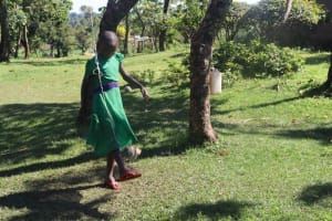 The Water Project: Lukala West Community, Angatia Spring -  A Girl Playing Football Using A Homemade Ball