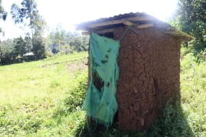 The Water Project: Lukala West Community, Angatia Spring -  A Toilet With Torn Sugarsack As A Door