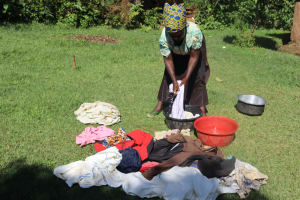 The Water Project: Lukala West Community, Angatia Spring -  A Woman Washing Her Clothes
