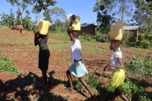 The Water Project: Lukala West Community, Angatia Spring -  Girls Leaving The Spring