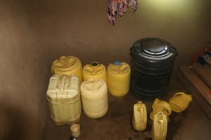The Water Project: Lukala West Community, Angatia Spring -  Water Storage Containers Inside The House