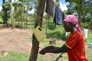 The Water Project: Shikokhwe Community, Mulika Spring -  Juliet Handwashing With A Leaky Tin