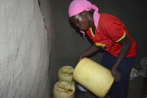 The Water Project: Shikokhwe Community, Mulika Spring -  Juliet Adding To Water Storage