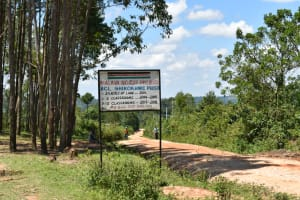 The Water Project: Shikokhwe Community, Mulika Spring -  Sign For Nearby School