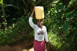 The Water Project: Malekha West Community, Soita Spring -  Carrying Water